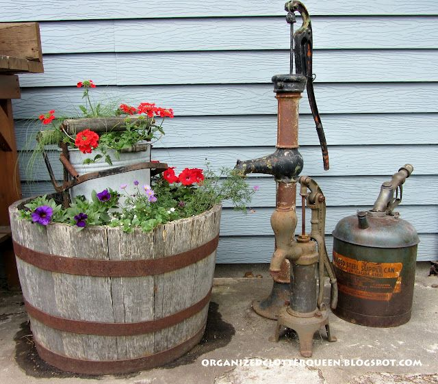 Vintage water pumps and gas nozzle/can. Mop bucket.