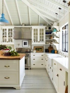 Take a tour of this charming two-story cottage that shares a mix of light and dark rooms. Unique architectural details can be seen throughout.