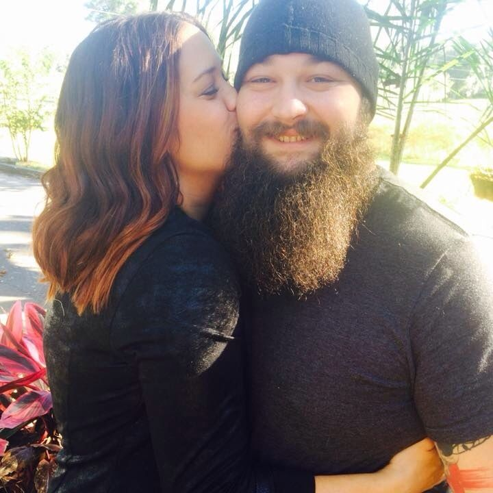 WWE Superstar Bray Wyatt (Windham Rotunda) gets a sweet kiss from his wife Samantha