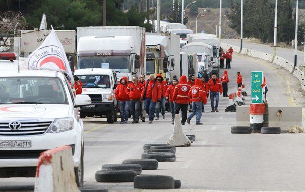 An aid convoy from the Syrian Arab Red Crescent waited on the outskirts of Madaya, Syria, on Thursday. Credit Louai