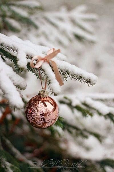 White flocked christmas tree with rose gold bauble
