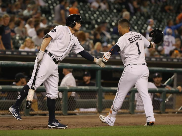 Tigers vs. Yankees series:   Jose Iglesias celebrates a ninth-inning home run with Alex Presley in the Tigers' 10-2 loss to the Yankees at Comerica Park on Aug. 23, 2017.  Gregory Shamus, Getty Images 31 of 57AutoplayShow ThumbnailsHide Captions Last SlideNext Slide