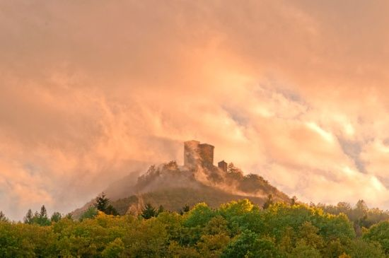 Castle in the clouds Art Print After a rain around Trifels castle (above Annweiler, Germany) it got very warm again, the water raised to the sky again and covered the castle in huge clouds. The warm light came from the sun, it was late evening. It's a photo, not edited! you find this castle in some other pics, like this: http://society6.com/pirminnohr/historical-landscape_print#1=45 Landscape, Germany, trees, forest, illumination, historical building