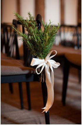 From 100 Layer Cake, photo by Caught the Light, Event styling done by Mary Lee Herrington of Forever & Ever Events, Florist: Chantal Flores Design....evergreen branches and ribbon on ends of chairs for ceremony, wedding decor, decorations,