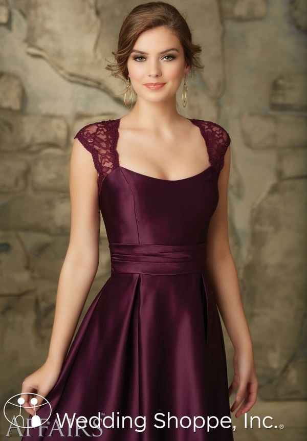 A beautiful satin and lace bridesmaid dress with keyhole back.