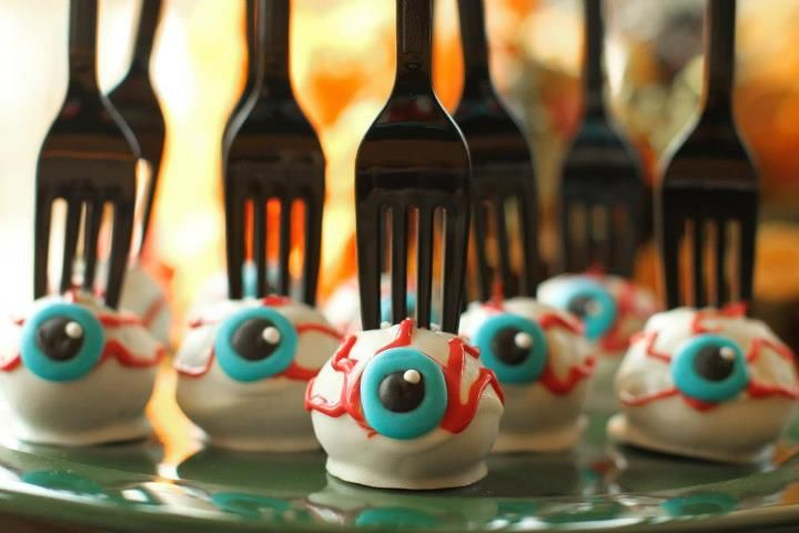 Best idea EVER for a Halloween bake sale - eyeball cake pops with a fork stuck in them! Gross, and easy to serve, perfect. Great for a lunchbox treat too.