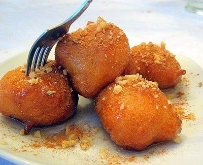 Loukoumades is a traditional Greek version of doughnut! Add honey,nuts and cinamon for a delicious desert course!