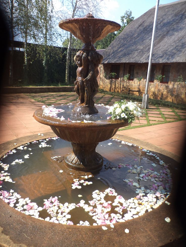 The rose petal theme extended to the water fountain...
