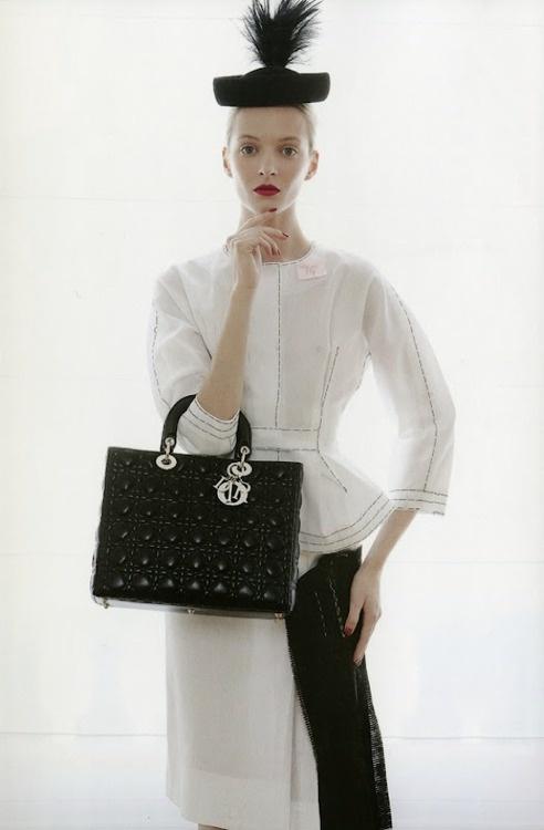 (I like the pose)..Dior in Vogue. #handbags