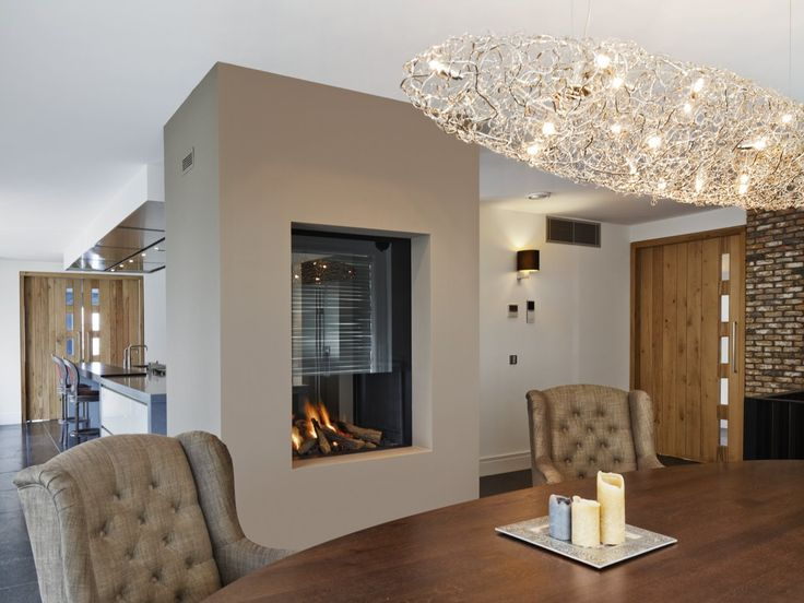 increase the height of your see-thru fireplace design with glass