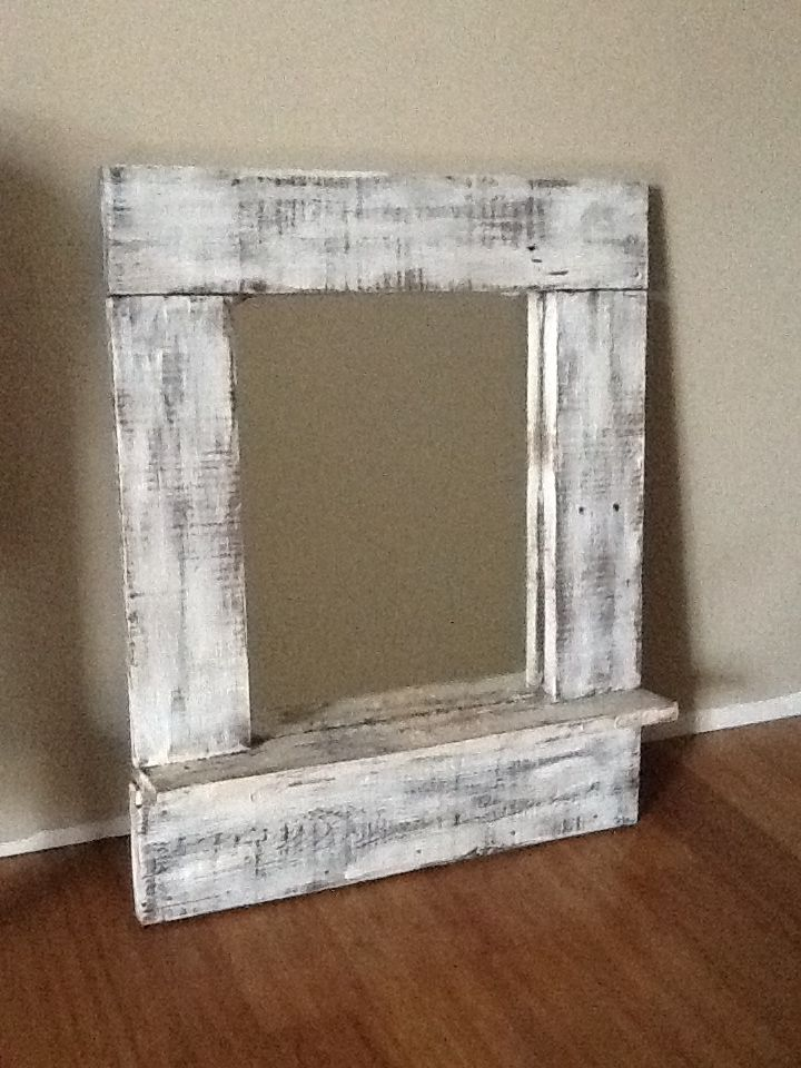 i took an old mirror made a frame from old pallet wood and painted to