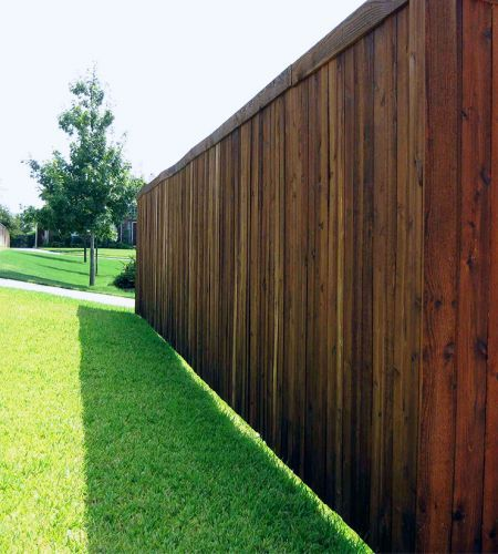 A properly constructed stockade fence substantiates property value with privacy.