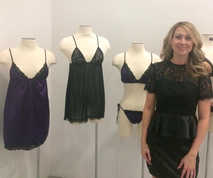 President of Bella Petite Lingerie, Stephanie Ballard standing next to her new line at Ones to Watch at Lingerie Fashion Week in NYC.