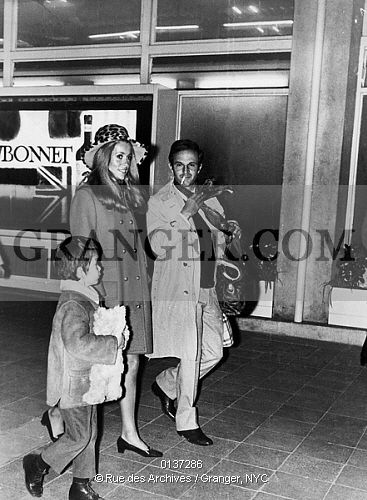 This is a Granger licensable image titled 'CATHERINE DENEUVE.  French actress Catherine Deneuve with her son Christian Vadim at Nice Cote d'Azur airport welcome by director Francois Truffaut december 30, 1968. Full credit: AGIP - Rue des Archives / Granger, NYC -- All rights reserv' by Granger, NYC All rights reserved. You may not copy, publish, or use this image except for sample layout ('comp') use only. You must purchase the image from Granger in order to use it f...