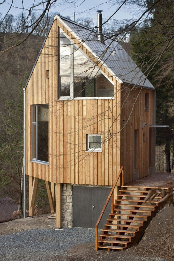 I like this one... modern yet traditional materials and good use of small lot