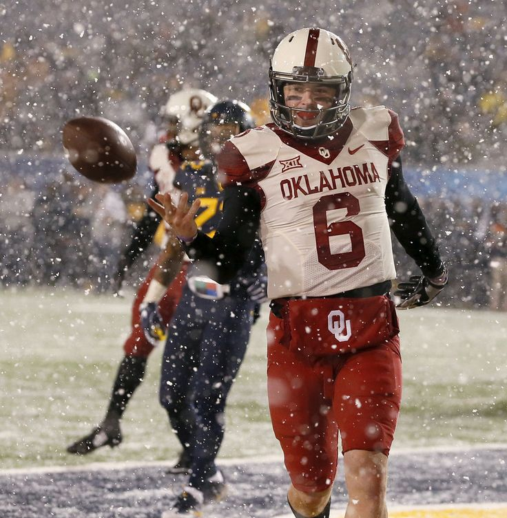 Oklahoma's Baker Mayfield (6) flips the ball to an official after scoring a touchdown during a college football game between the University of Oklahoma Sooners (OU) and and the West Virginia University Mountaineers (WVU) on Mountaineer Field at Milan Puskar Stadium in Morgantown, W. Va., Saturday, Nov. 19, 2016. Oklahoma won 56-28. Photo by Bryan Terry, The Oklahoman