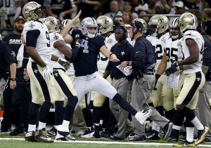 Derek Carr celebrates after somersaulting his way to a first down.