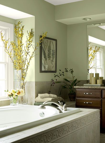 I love this pale green bathroom! I would do ivory or cream colored tile with it, and a dark vanity. I love the sage/cream candles, too!