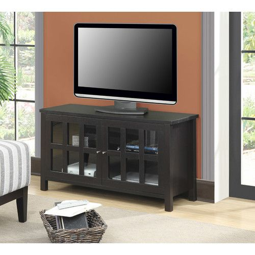 """Features:  -Newport collection.  -2 enclosed cabinets.  -2 Shelves.  -Cable management holes for portable devices.  Design: -Enclosed storage.  TV Size Accommodated: -46"""".  Product Type: -TV Stand.  F"""