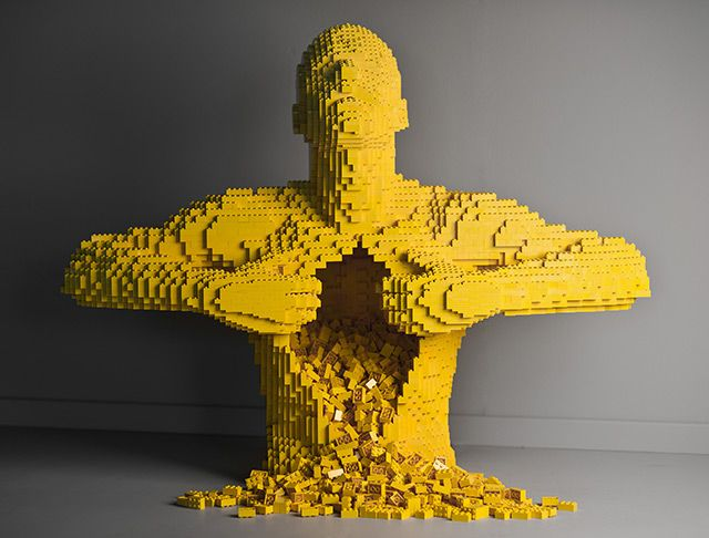 Made by Nathan Sawaya. The sculpt has definite edges and shape. It seems rough and block like.