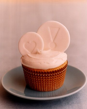 Fondant wafers, rubber-stamped with a hearts and exclamation point, top this sweet cupcake