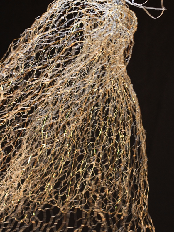 "Sculpture gown ""inhabited"" by invisible woman/ bronze, iron and brass wire, beveled crystals"