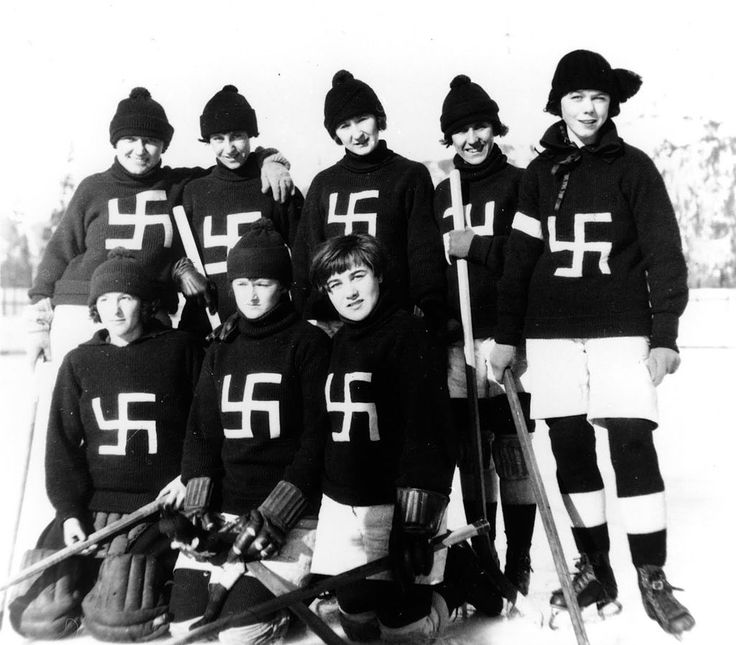 The Fernie Swastikas hockey team taking a group picture in British Columbia wearing sweaters with their team logo that represented good luck and peace [1922]