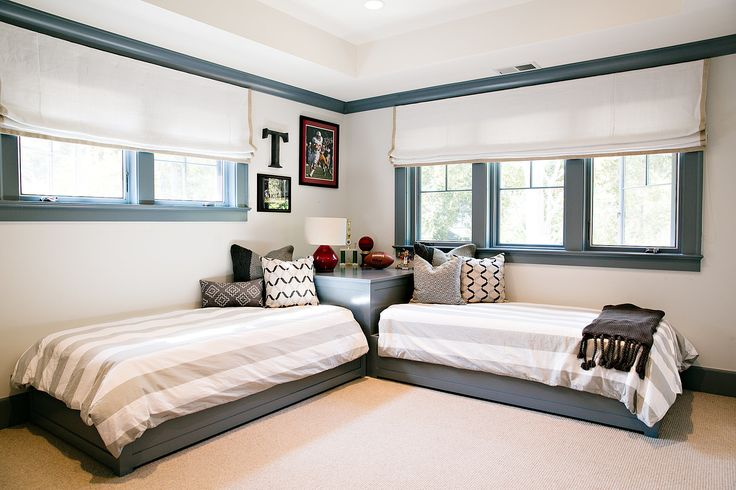 In a long, skinny room, put two twin beds head to head so they're sharing a headboard, thus saving valuable floor space. — Nest Design Co., Inc.