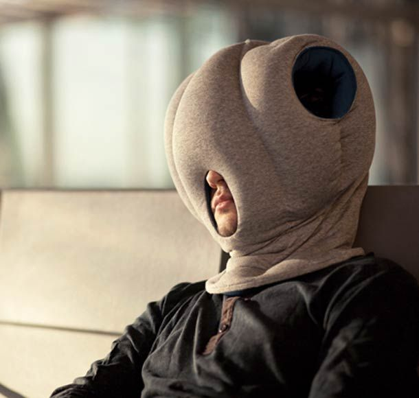 """Ostrich Pillow"" is a strange gadget created by designers Kawamura-Ganjavianqui which lets you fall asleep anywhere… A very comfortable WTF gadget, halfway between the pillow and the hood, but you will look like an alien of course!"