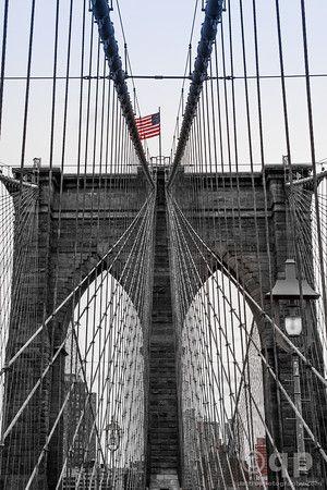 Brooklyn Bridge and flag. NY, NY. Prints available