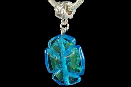 transparent light blue glass, leaf shape, with 24k gold foil. Lenght mm. 25.