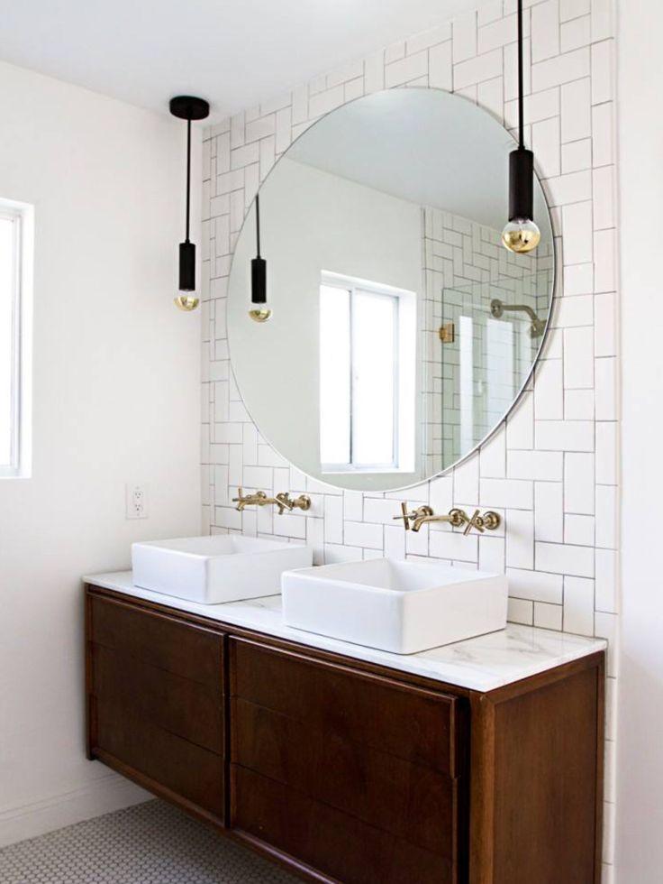 Subway tiles, vessel sinks, dark wood vanity, penny tiles on floor