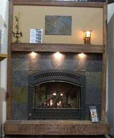 Fireplace with slate around it and lighting under the mantel - nice!