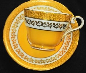 AYNSLEY GOLD CHINTZ YELLOW CREAM TEA CUP AND SAUCER