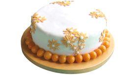 Alquimia | Productos -Torta de bodas tradicional (masa de frutas) cubierta en masa elástica, decorado con flores y rematado con aguaymantos.