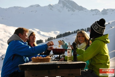 Having a Fondue (the famous Swiss cheese dipping menu) in the Flumserberg Mountains.