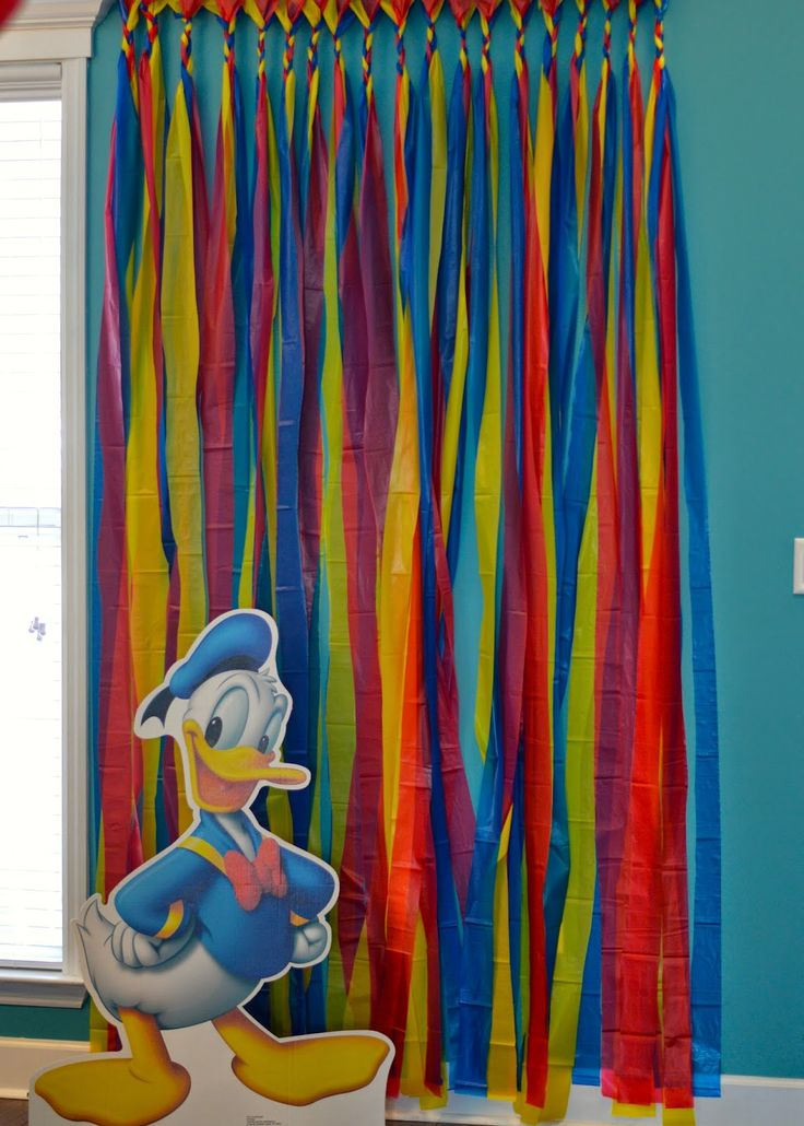Donald Duck Birthday Party Decor- Diy photo booth backdrop using dollar store table cloths!