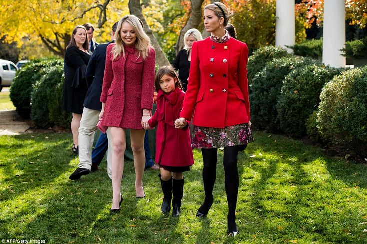 Ladies in red: Tiffany Trump (left) and Ivanka Trump (right) hold hands with Ivanka's oldest Arabella (center) at the White House turkey pardoning ceremony on Tuesday