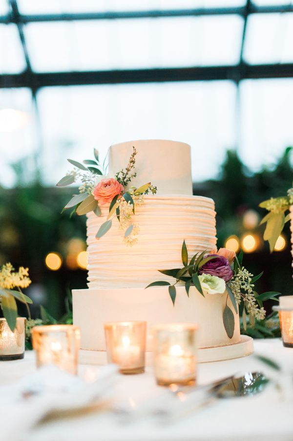 wedding cake with peach ranunculus - photo by Kelly Sweet Photography http://ruffledblog.com/botanical-garden-wedding-with-glass-ceilings #weddingcake #cakes