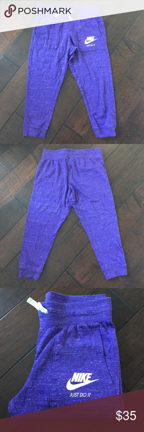"Nike Gym Vintage Capri Pants Nike Gym Vintage Capri Pants.  Mid-rise, elastic waist/draw string. Inseam 19"".  Size Small, Color Purple.  Excellent Like New Condition, worn once.  No trades. Nike Pants Capris"
