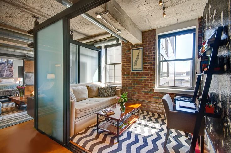 Industrial Great Room with Carpet, The Sliding Door Company Glass Room Dividers, Cambridge Navy Transitional Rug, flush light
