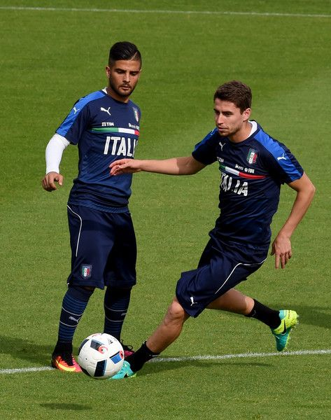 Lorenzo Insigne (L) and Jorginho of Italy in action during the Italy training session at the club's training ground at Coverciano on May 27, 2016 in Florence, Italy.