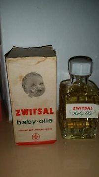 Zwitsal baby-olie in verpakking . Blikje babyzalf.