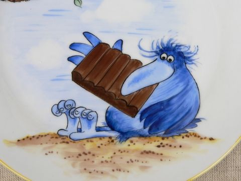 Gomboc Artur(Arthur Dumpling) is a character from the Hungarian cartoon called Pom Pom mesei. He is a bird who loves every kind of chocolate and eats them all the time.