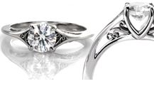 Our unique line of filigree engagement rings feature beautiful scroll work done in platinum, rose gold, and yellow gold. Our styles are reminiscent of Edwardian and Victorian era designs. Our filigree is made by hand from wire and is not cast. Filigree can be the primary focus of a design or a simple embellishment.