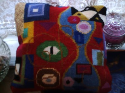 This is a small cushion cover based loosely on the work of Gustave Klimt. I took shapes and colours from sections of his densely detailed paintings, especially where he...