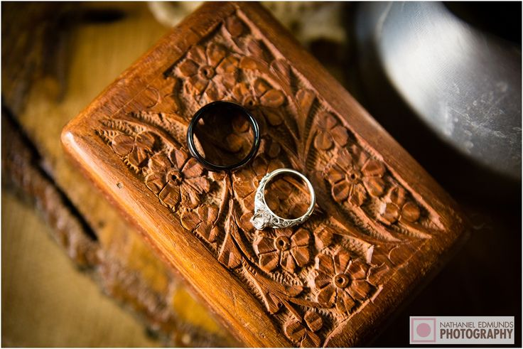Rings on top of a beautiful wood carving. #weddings #rings #wood #woodcarving #nepweddings #weddingphotography