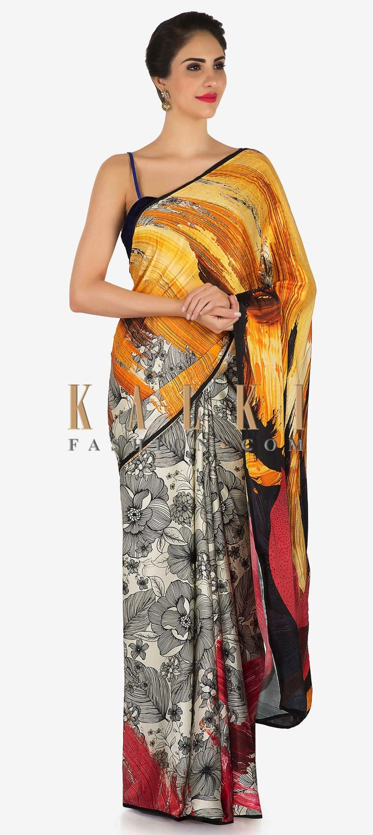 Buy Online from the link below. We ship worldwide (Free Shipping over US$100)  Click Anywhere to Tag Off white and saree with shaded pallav in floral print only on Kalki  Off white and yellow saree featuring in crepe. Its enhanced in floral print al over. Matched with unstitched blouse in black with lotus motif in zari work. Slight variation in color is possible.