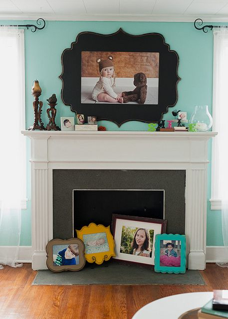 these great picture frames are from theorganicbloom.com... but.. I bet I could paint this shape on the wall and then center a flat screen tv on it for a similar look