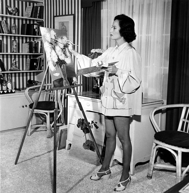 Merle Oberon paints at home, 1948.